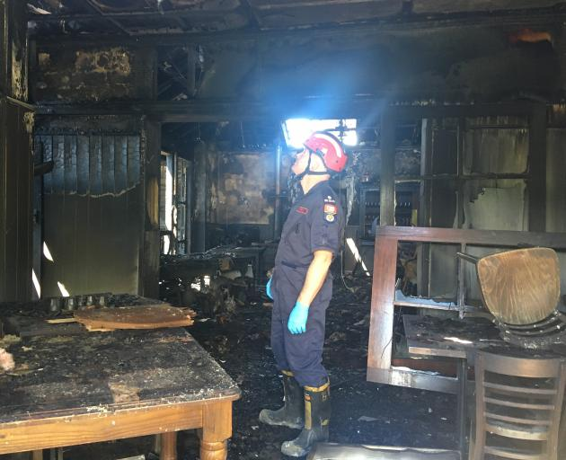 Fire investigator Mark Bredenbeck assesses damage to the communal area at Naseby's Ancient Briton Hotel yesterday. Photo: Adam Burns