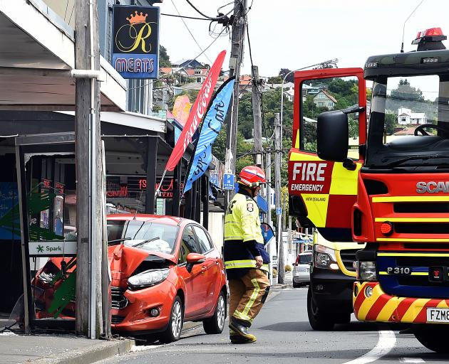 A vehicle hits a phone box and pole on Hillside Rd near Loyalty St. Photo: Staff Photographer