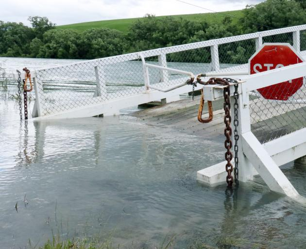 The Tuapeka Mouth punt on-ramp has been closed after being partly submerged under the rising Clutha River. Photo: Jack Conroy
