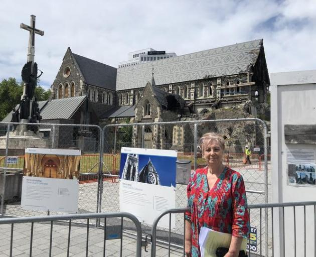 Anna Crighton outside  the Christ Church Cathedral behind her. Photo: RNZ / Sharon Brettkelly