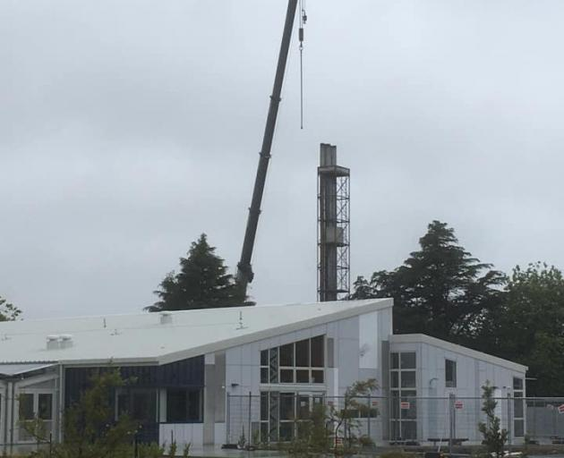 The boiler house chimney at the old Hornby High School site is being demolished. Photo: Supplied