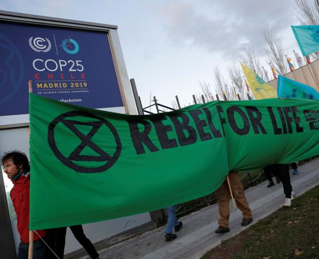 Members of Extinction Rebellion stage a protest outside the COP25 meeting in Madrid. Photo: Reuters
