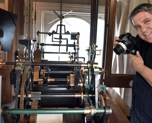 Calvin Blyde, of Tauranga, prepares to take digital images inside the Dunedin Municipal Chambers...