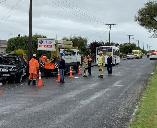 Emergency services at the scene of a crash in Invercargill after a bus hit a parked vehicle. Photo Abbey Palmer
