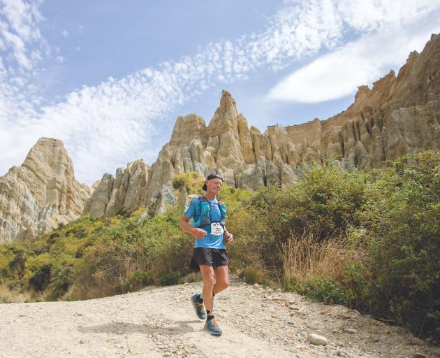 Eric Ross jogs past the Clay Cliffs in the Alps 2 Ocean Ultra earlier this year. Photo: Supplied