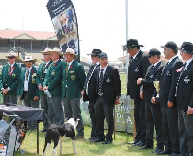 The Australian and New Zealand sheep dog trials test teams line up for the prizegiving after the Wayleggo Cup test series last month. Photo: Supplied