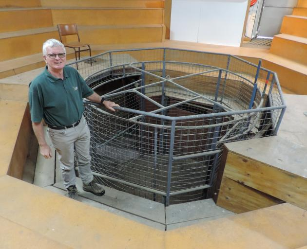 Barry Gard demonstrates the cage inside the Foveran selling arena. Two deer are loaded in at ground level then a garage hoist raises the platform until the deer are fully visible to the people sitting around the ring. The cage is turned by hand to give ev
