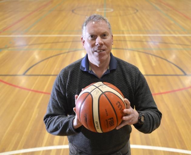 New Basketball Otago general manager Peter Drew takes a break from work on court at the Edgar Centre yesterday. Photo: Gerard O'Brien
