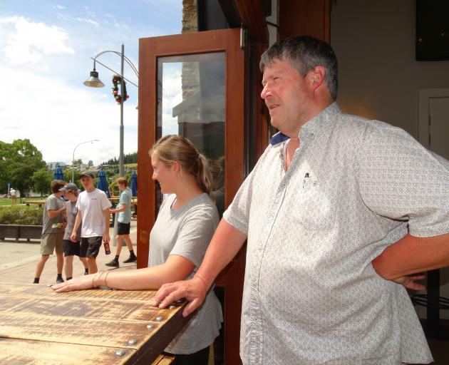 Lake Bar owner Peter Byrne and restaurant manager Erin Officer get ready to greet their first...