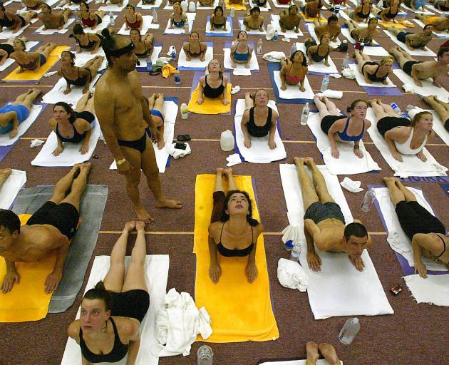 Yoga guru Bikram Choudhury (standing) at the Bikram Yoga College of India in Los Angeles. Photo:...