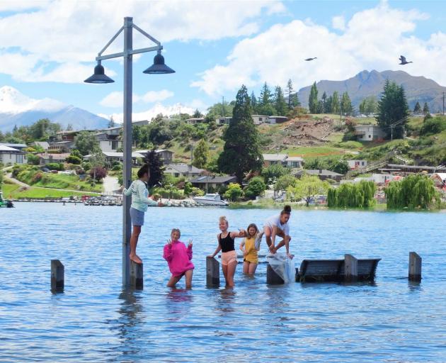 Many young people were enjoying the new, temporary water playground along Lake Wanaka yesterday....