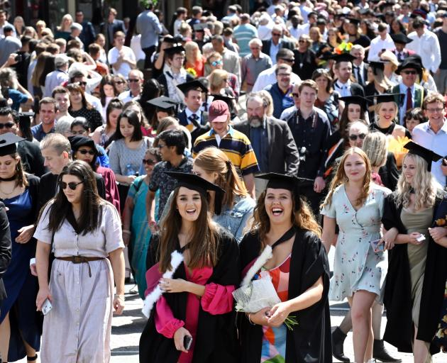 Biomedical students Maddie Mason (20, centre left) and Susie Grigg smile during the procession.