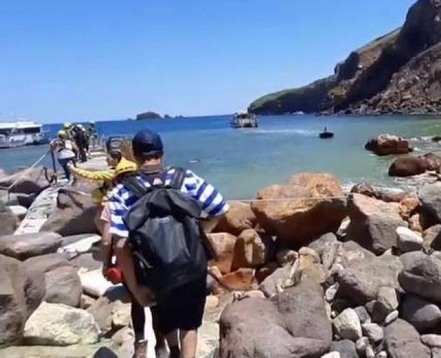 Tourists and guides ready to depart the island prior to the explosion. Photo: via YouTube