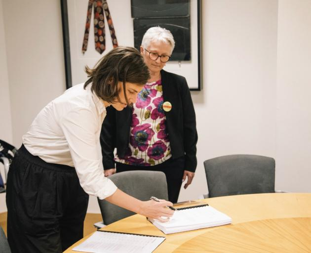 Corinda Taylor watches Green MP Chloe Swarbrick as she accepts her petition in Wellington yesterday. Photo: Supplied