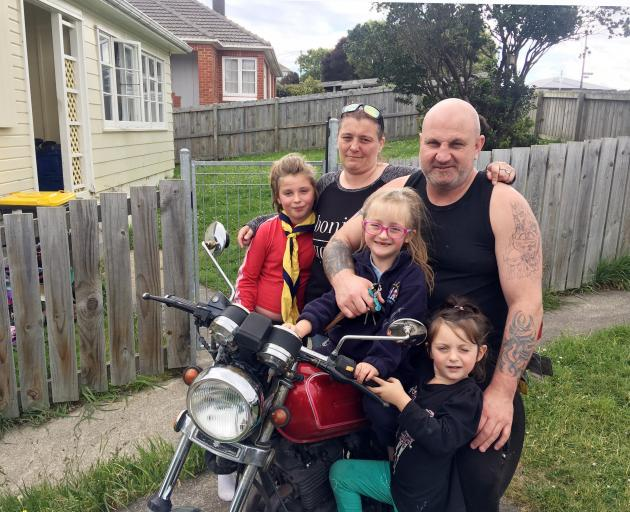 Tania Young (36) and Neil Ross (36) with three of their four children (from left) Jamiccia (9),...
