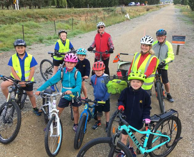 Cycling the  Otago Central Rail Trail, on their way to have their petition heard at yesterday's Central Otago District  Council meeting are (clockwise, from left) Zavier Robb (12) Julius Gorman (12), Anika Robb (8), Lynn Stewart, Doug White, Elina Kiuru,