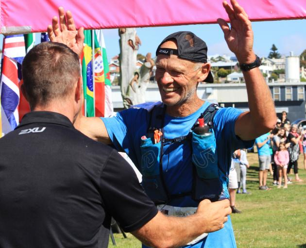 Eric Ross greets Alps 2 Ocean Ultra race director Mike Sandri at the Oamaru Harbour at the end of the 323km Alps 2 Ocean Ultra on March 2. Photo: Hamish MacLean
