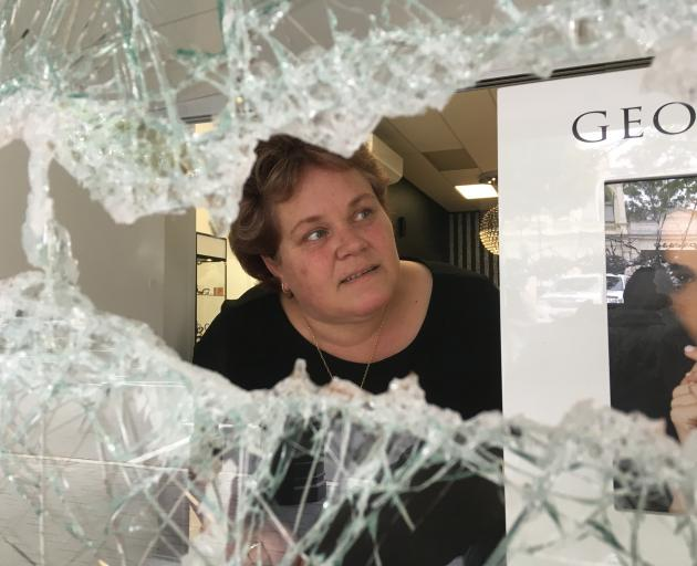 Ballantynes Showcase Jewellers owner Wendy Bradfield inspects damage to her shop in lower Thames St, Oamaru, yesterday after a front window was smashed and jewellery taken. Photo: Daniel Birchfield