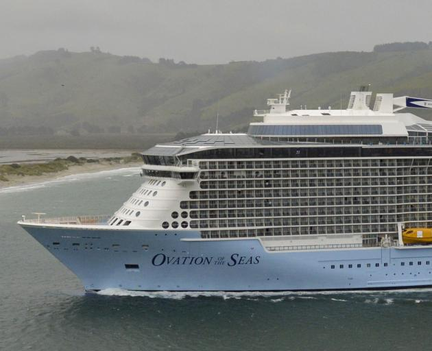 Ovation of the Seas sails through wind and rain into Otago Harbour yesterday morning. Photo by Gerard O'Brien.