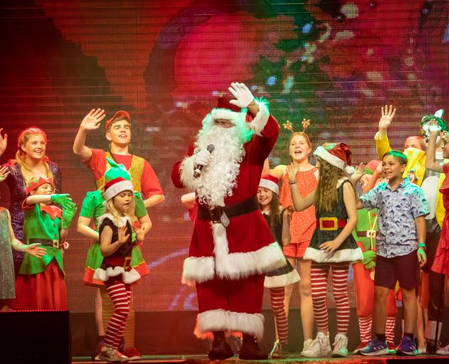 Santa (Chris McKenzie) and cast farewell the audience at the end of Queenstown's annual Christmas...