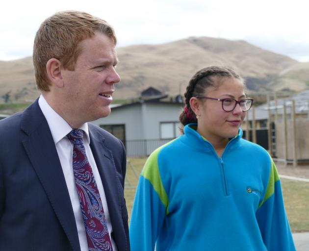 Minister of Education Chris Hipkins tours Shotover Primary School with pupil Iritana Matenga (12)...