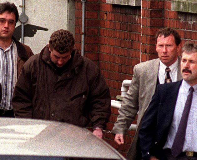 Gareth Smither (wearing brown) leaving court in 1997. Photo: ODT files