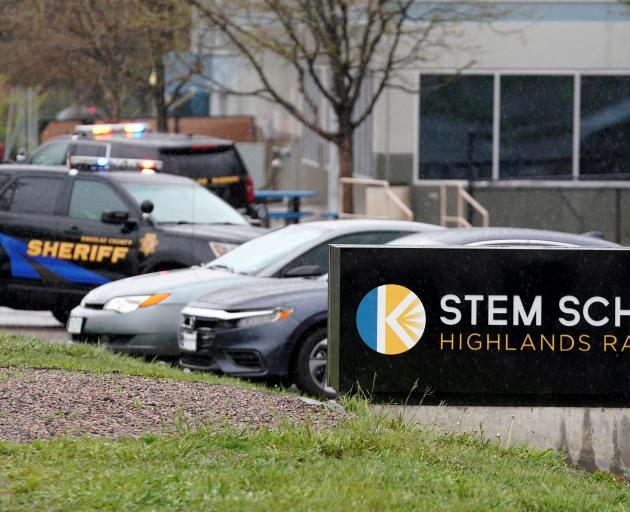 Police vehicles are stationed outside the school following the shooting at the Science, Technology, Engineering and Math (STEM) School in Highlands Ranch. Photo: Reuters