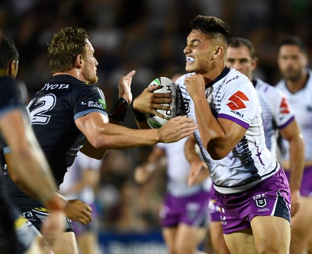 New Warriors signing Tino Fa'asuamaleaui takes the ball into contact for the Melbourne Storm last...