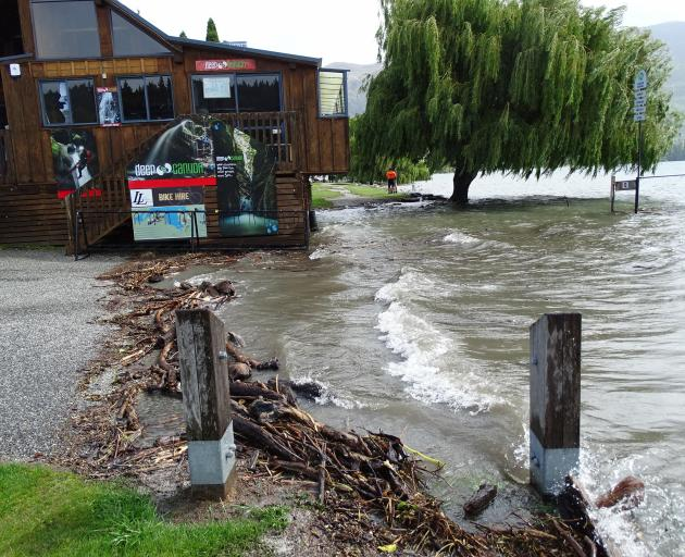 Water was at the back door of Lakeland Wanaka's wooden cabin by yesterday afternoon. Photo:...