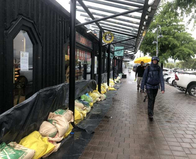 Wanaka's Doughbin continued to trade during the day and tourists wandered down Ardmore St as...