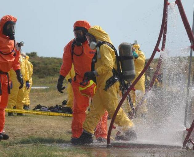 Recovery teams go through the decontamination process after returning from Whakaari/ White Island yesterday. Photo: NZ Police
