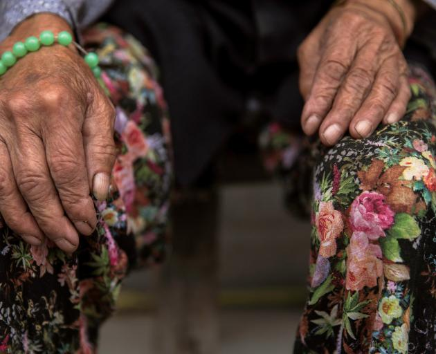 Hands may get wrinkled, but minds can stay sharp. Photo: Reuters