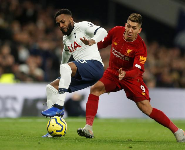 Tottenham Hotspur's Lucas Moura (left) competes for the ball with Liverpool's Adam Lallana. Photo...