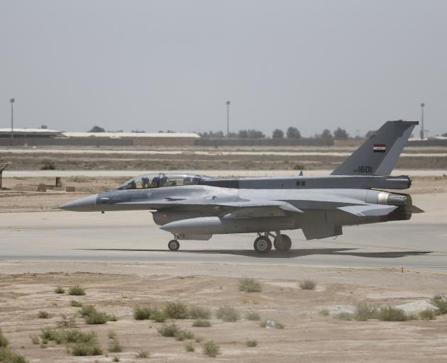 A U.S. F-16 fighter jet is seen on the tarmac if a military base in Balad, Iraq, July 20, 2015....