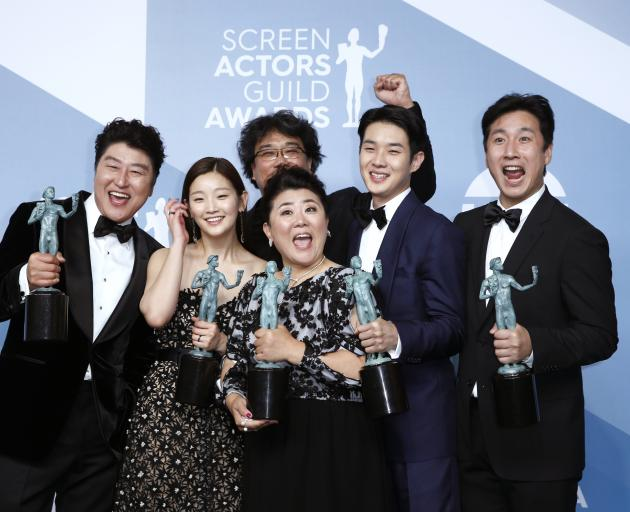 The cast of Parasite celebrate winning the SAG award for Outstanding Performance by a Cast in a...