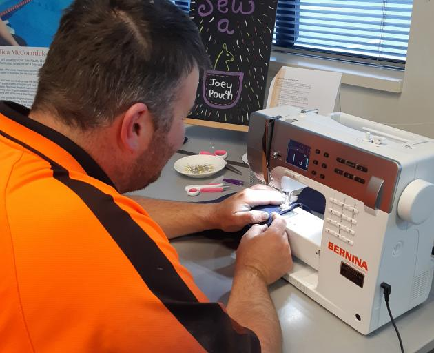 Southbridge resident Ben Wilson dropped in to Leeston Library to sew a joey pouch for the...