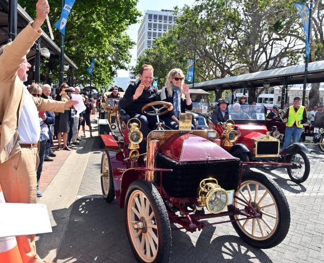 Race starter Dunedin city councillor Lee Vandervis (left) waves away the first veteran car, a...