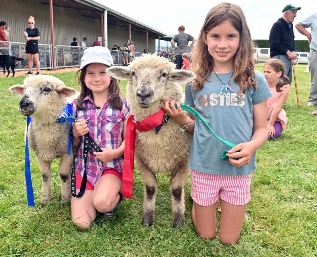 Olivia O'Neill (6, left) and her sister Mikayla (8) show off pet lamb Minty and Choc at the Otago...