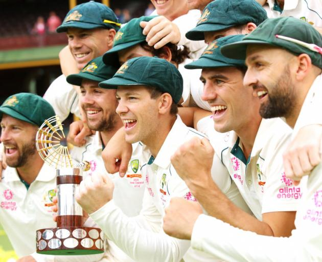 The Australian team celebrate with the Trans-Tasman trophy after victory during day four of the Third Test Match in the series between Australia and New Zealand. Photo: Getty Images
