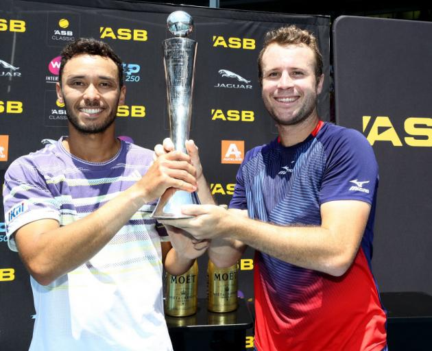 Ben Mclachlan (left) and Luke Bambridge after winning the men's doubles at the 2020 ASB Classic. Photo: Getty Images