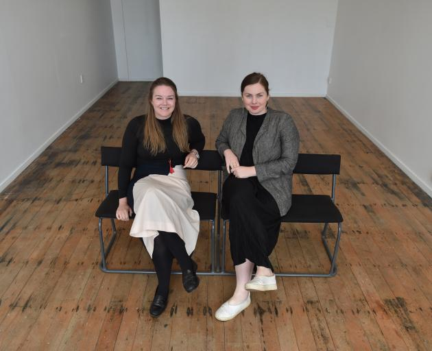 Grace Ryder (right) hands over the reins of the Blue Oyster Art Project Space to Hope Wilson earlier this month. Photos: Gregor Richardson