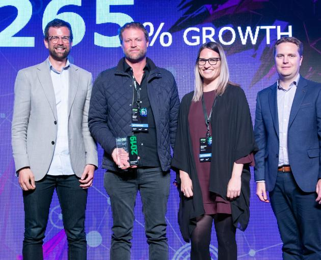 BNZ Head of Tech Tim Wixon (left) with Bookme founder and CEO James Alder, Shannon Winn and Deloitte partner Simon Chapman win Master of Growth index. Photo: Supplied
