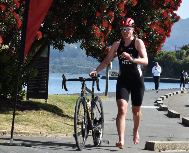 Cecilia Crooks heads for transition following the 20km cycle stage on her way to winning the open...