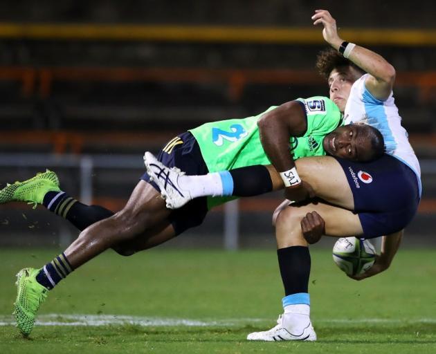 Chris Kuridrani tackles Mark Nawaqanitawase during the Highlanders' trial game against the...
