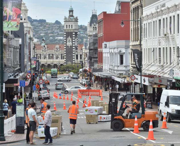 Contractors place planter boxes in lower Stuart St yesterday afternoon. PHOTO: GERARD O'BRIEN