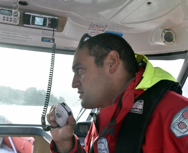 Coastguard Dunedin volunteer Tea Gilbert is a new member and still learning the ropes, guided by...