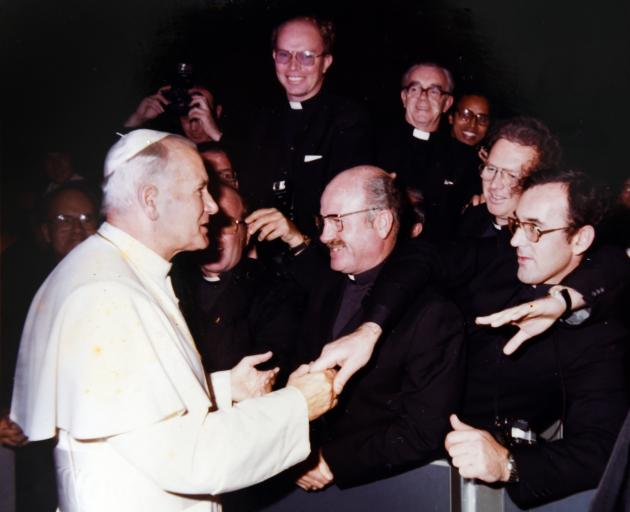 Br Donaldson (pictured centre) meets Pope John Paul II during a sabbatical at the Vatican in 1982. Photo: Supplied