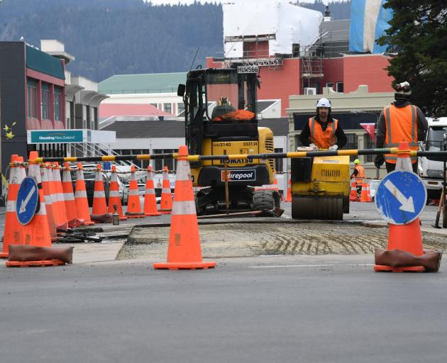 The sight of Downer contractors working on Dunedin's Southern Motorway will soon be a thing of the past. Photo: Stephen Jaquiery