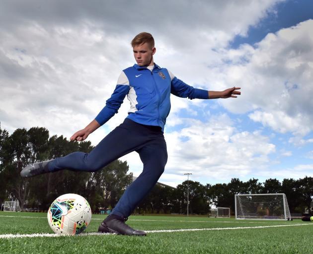 Southern United defender Andrew Cromb shoots at goal at Logan Park Turf this week. PHOTO: GERARD O'BRIEN