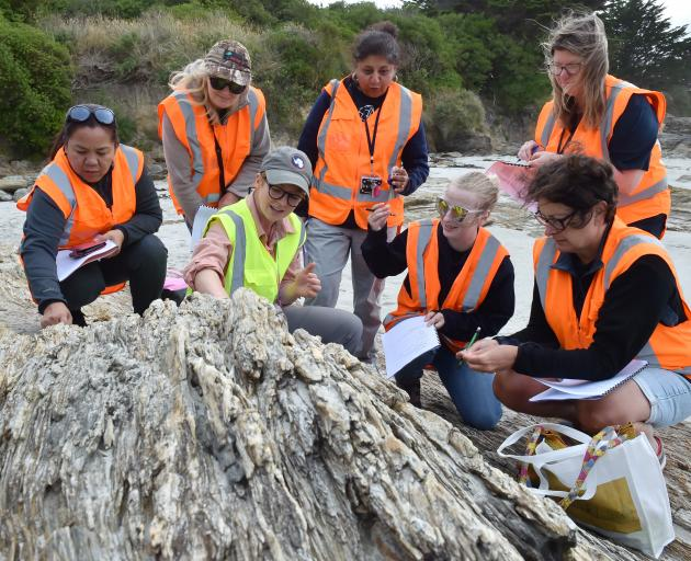 University of Otago geology department teaching fellow Dr Sophie Briggs (centre left) explains the features of Haast schist at Brighton beach, near Dunedin, to teachers (from left) Socorro Lakaga (St Kevin's College), Alison Waller (Opotiki College), Shob